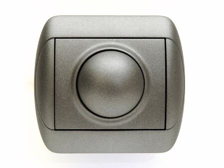 dimmer: metal electric switch isolated at white background