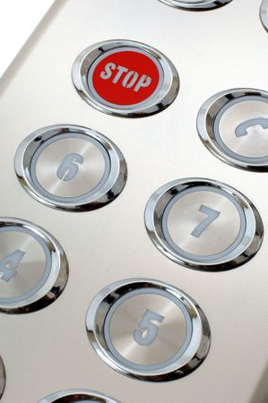 stop button: metal red stop button in the elevator Stock Photo