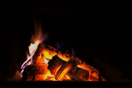 Burning fire place on a Winter evening Stock Photo - 11819766
