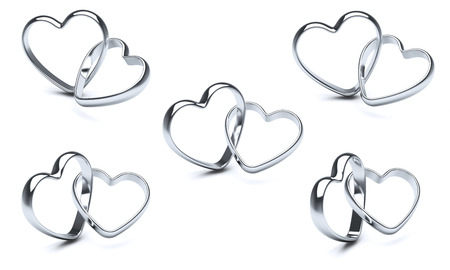 heart background: Silver heart rings. Stock Photo