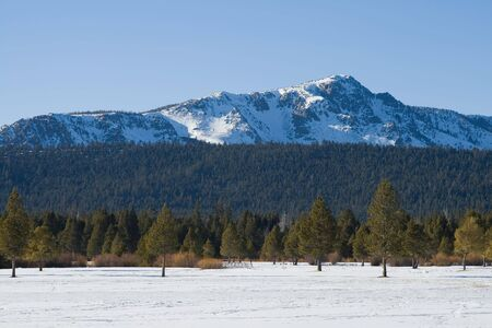 Big snowy mountains next to Lake Tahoe in Winter Stock Photo - 6148815