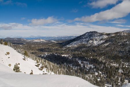 Big snowy mountains next to Lake Tahoe in Winter Stock Photo - 6148746