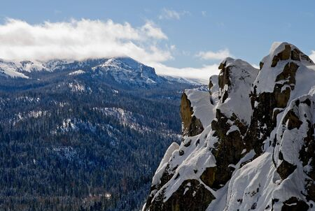 Big snowy mountains next to Lake Tahoe in Winter photo