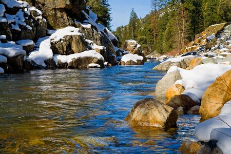 Clear river in the woods in Winter photo