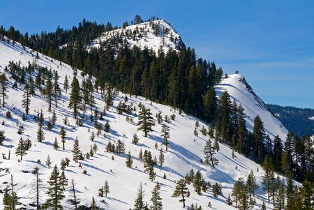 Big snowy mountains next to Lake Tahoe in Winter Stock Photo - 6147145