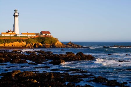 Pigeon Point Lighthouse in California at sunset photo