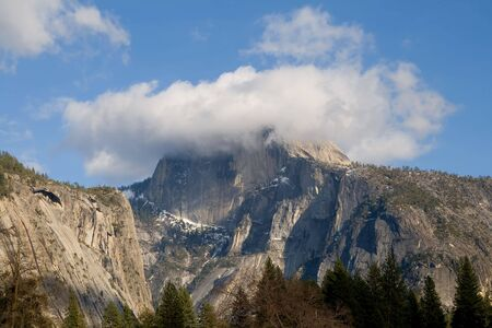 half dome: Half Dome covered in fog in Yosemite National park