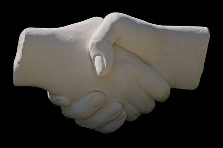 stone statue handshake on a black background