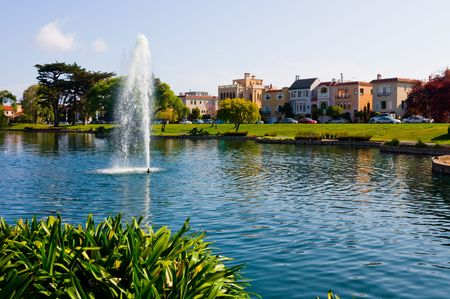 Colorful houses next to a lake in San Francisco photo