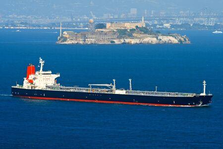 Cargo ship passing by Alcatraz in San Francisco California Stock Photo - 6387862