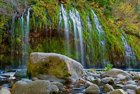Waterfall in the mountains in Northern California photo