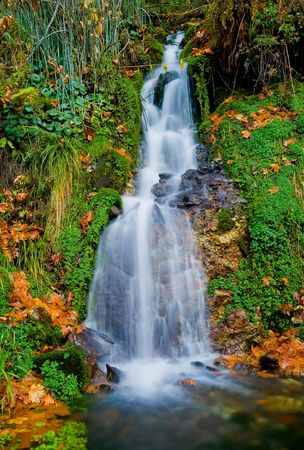 Waterfall in the mountains in autumn