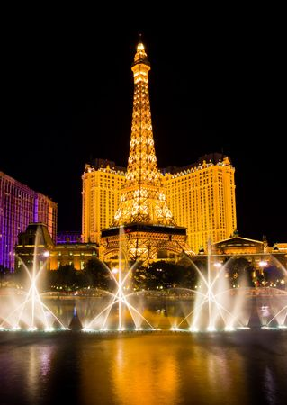 LAS VEGAS - APRIL 1: Musical fountains next to Eiffel Tower and Hotel Paris on April 1, 2009