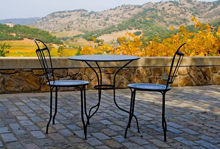 napa valley: Tables and chairs outside the winery in Napa Valley in Autumn at sunset  Stock Photo