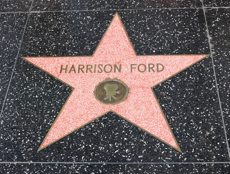 HOLLYWOOD - SEPTEMBER 4, 2011: Harrison Fords star on Hollywood Walk of Fame on September 4, 2011 in Hollywood, California. This star is located on Hollywood Blvd. and is one of 2400 celebrity stars.