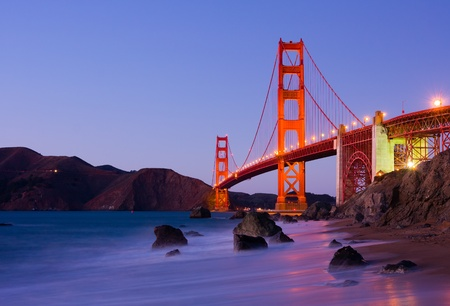 golden: Golden Gate Bridge at night Stock Photo
