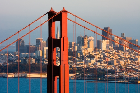 golden: Golden Gate Bridge and downtown San Francisco at sunset Stock Photo