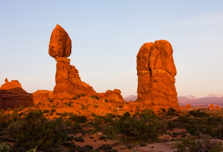 arches national park: Balanced Rock in Arches National Park near Moab, Utah at sunset