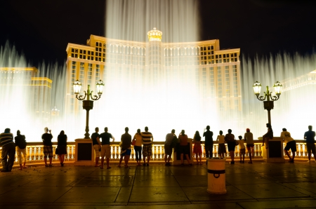 hotel casino: Las Vegas, USA - August 12, 2012: The Fountains of Bellagio is a vast, choreographed water feature with performances set to light and music.