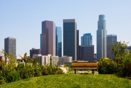 los: Skyscrapers in  Los Angeles with a bench in a foreground