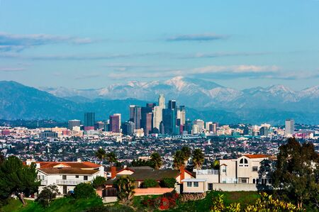 hollywood hills: Los Angeles with snowy mountains in the background
