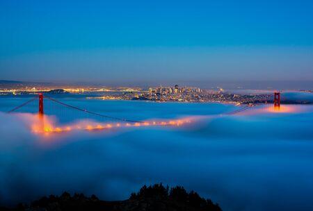 San Francisco and Golden Gate Bridge on a foggy night