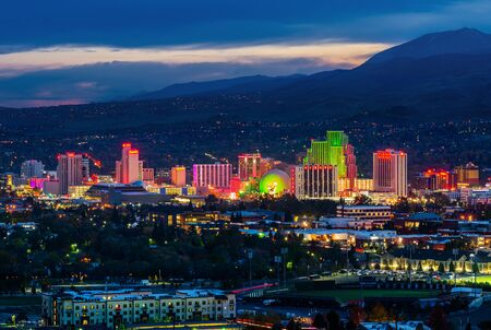 RENO - OCTOBER 30, 2014: Reno skyline on October 30, 2014. It's known as The Biggest Little City in the World, famous for casinos and the birthplace of the gaming Harrah's Entertainment.