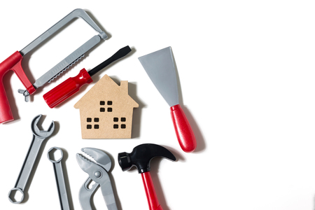 Wooden houses and mechanics and the use of financial planning, banking, home repair loans, and engineer or technician safety Stock Photo