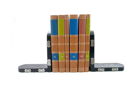 Bookends supporting six colorful books. Stock Photo
