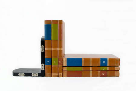 Black bookend supporting six colorful books.