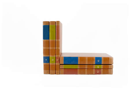 Six colorful books stacked and upright. Stock Photo