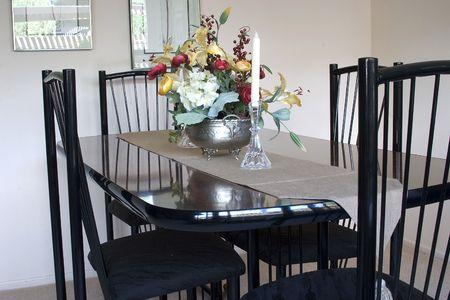 Black dining room table with decorative center piece arraingment