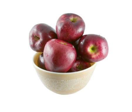 A bowl of red apples with water drops. Includes clipping path.