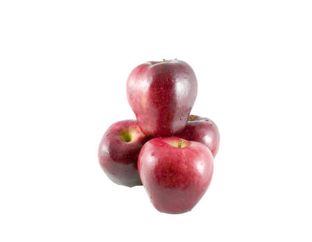 A stack of four red juicy apples.  Includes clipping path.