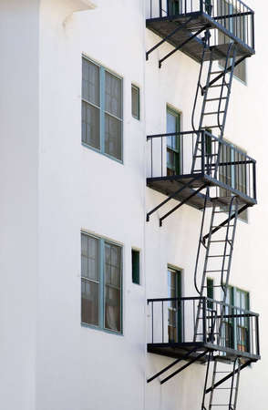 Partial view of fire escapes on a multi story building.