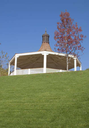 Replica of a Victorian bandstand surrounded by a grassy amphitheater.
