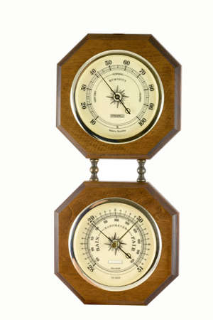 A hygrometer instrument showing the relative humidity in percents and a barometer instrument indicating the barometric pressure in inches.