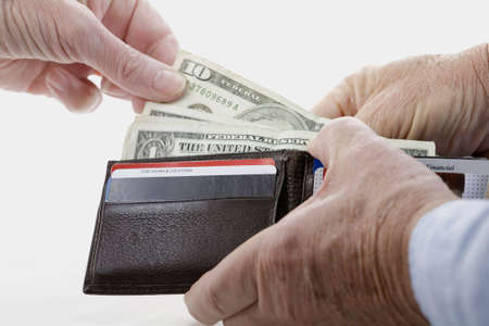 Image of a hand taking money from a working mans wallet over a white background, Imagens