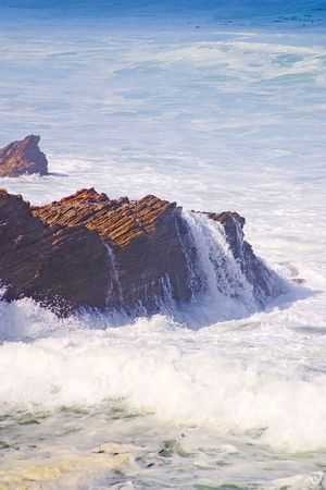An early morning stroll to observe the beauty of the active shoreline and waves against the rock formations.