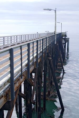 Walking pier extends out over the ocean for a relaxing stroll.