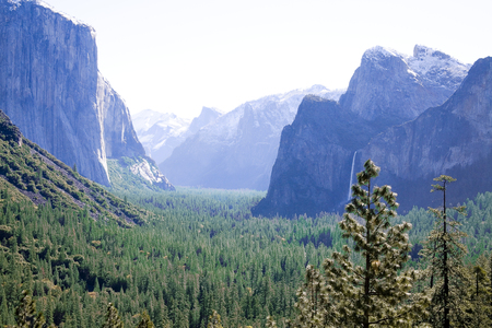 bridalveil fall: Photographed from the Wawona tunnel viewing area during late spring.  The view is of El Capitan, Half Dome and Bridalveil fall. Stock Photo