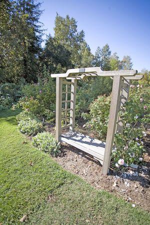 a wooden trellis bench is a peaceful garden