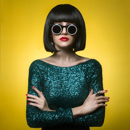 Studio fashion photo of beautiful stylish woman Foto de archivo