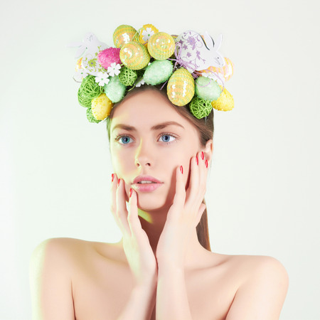 Beautiful Lady with easter eggs on her head.