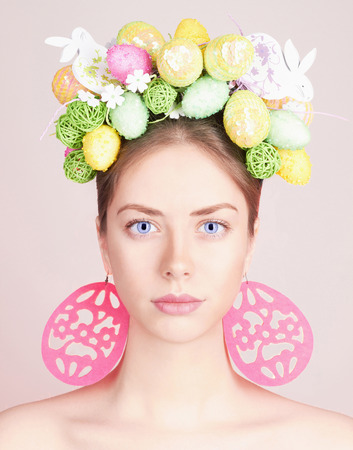 Spring Woman. Beauty model girl with colorful flowers. Easter Hair Style.