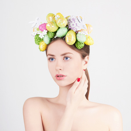 Spring Woman. Beauty model girl with colorful eggs. Holiday Easter concept