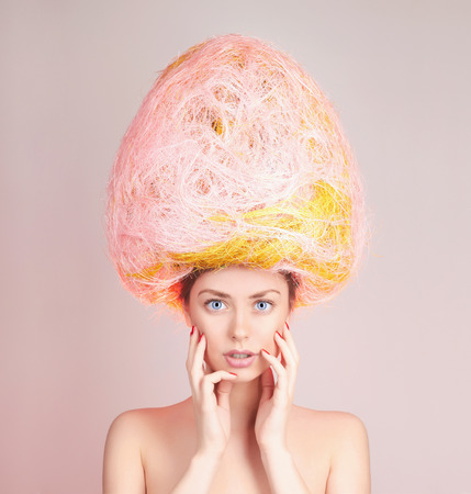 Beautiful Girl with easter egg on her head Foto de archivo