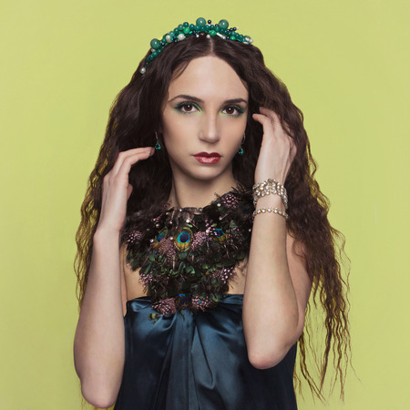 accesories: beautyful brunette young woman with accesories.fashionable girl.jewelery.plumage