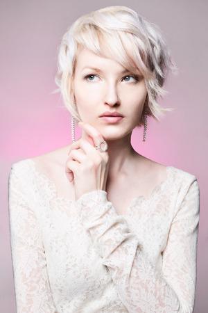 Fashion studio photo of beautiful lady with jewelry
