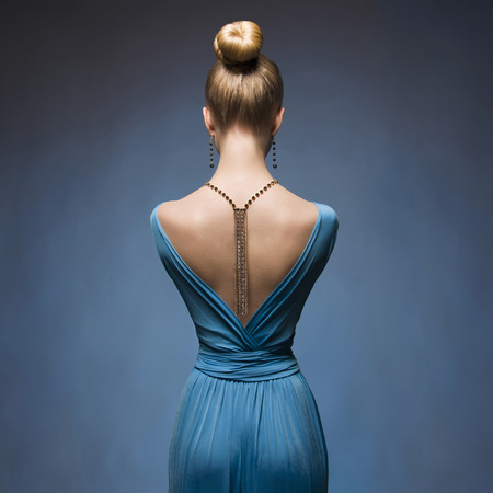 back light: Fashionable Sexy blond girl.Beaitiful young woman in blue dress.Accessories Stock Photo